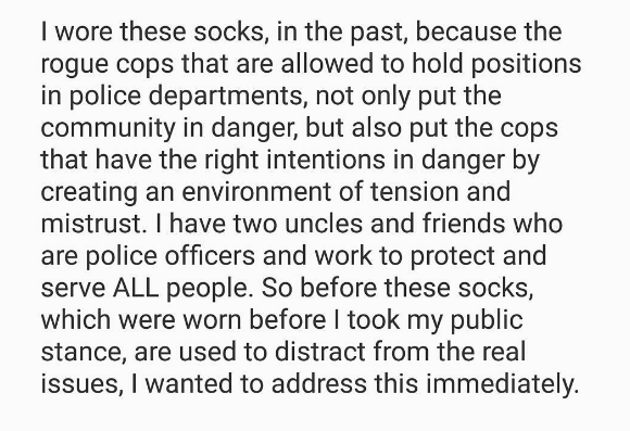 Colin Kaepernick wore socks with cartoon pigs in police uniforms and Twitter is blowing up